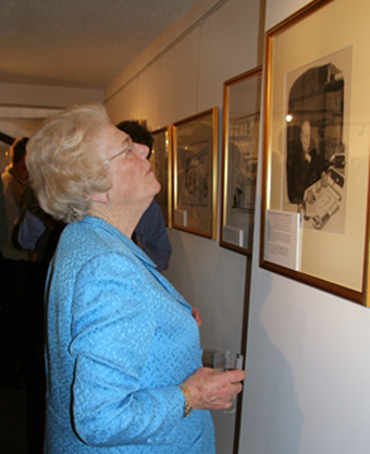 Winston Churchill's daughter, Mary Soames, looks at the infamous Illingworth cartoon at the Politcal Cartoon Gallery in May 2005